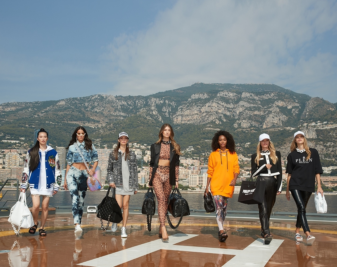 Girls in Philipp Plein outfits walking on a yacht
